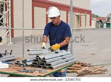 Worker Stacking Metal Studs