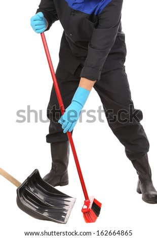 Worker sweeping floor. Isolated on a white background.