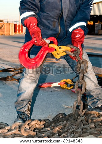 worker tries to lift hook #69148543