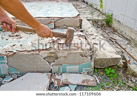 Worker used hammer destroy concrete floor