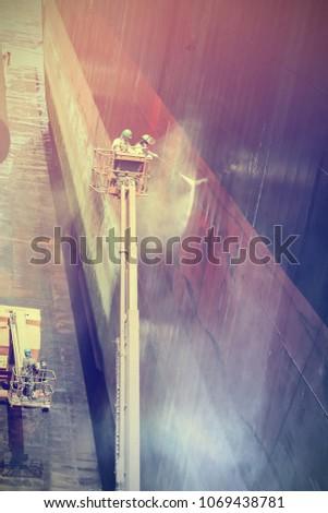 worker wash big ship in...