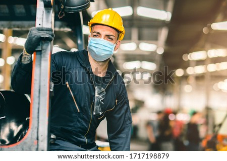 Worker wear disposable face mask for protection Corona Virus Spreading and Smoke dust air pollution filter in factory for healthy labor care.