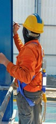 Worker wear safety harness for working at hight in construction site