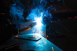 Worker welding construction by MIG welding, Worker welding the steel part by manual, welding splatter repairman, lifestyles, light weld
