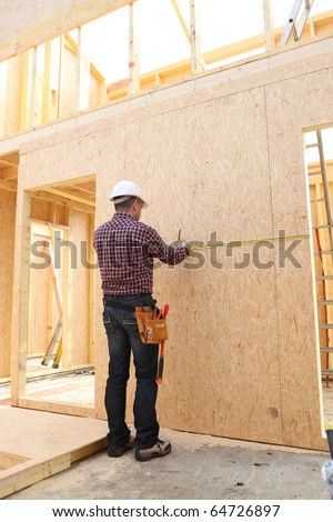 Worker with a hammer in hand - stock photo