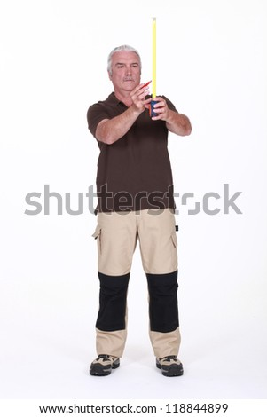 Worker with a tape measure