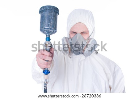 Worker with airbrush gun, selective focus on gun