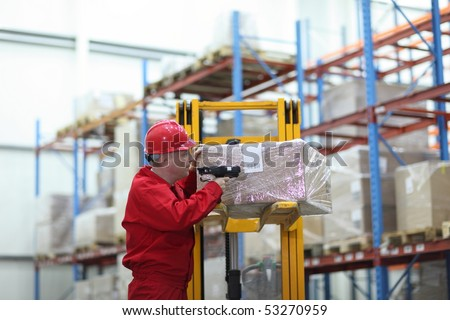 worker with bar code reader - close up