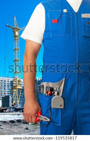 worker with equipment on building background sets