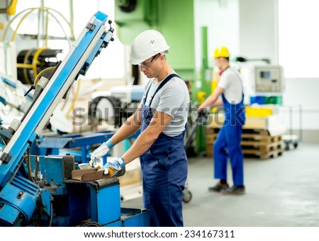 worker with goggles and helmet on the machine Stockfoto ©