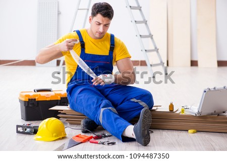 Worker with injured hand at construction site