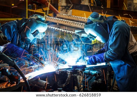 worker with protective mask welding metal  (welding, welder, steel)
