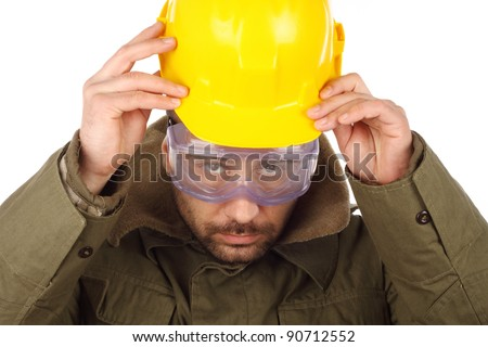 worker with yellow helmet over white - stock photo