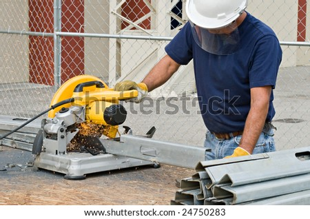 Worker Working with Saw