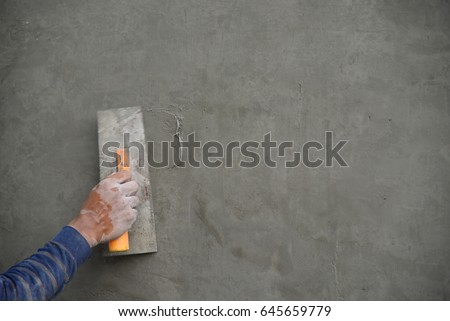 Workers are plastered walls.