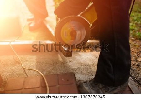 Workers are sawing a metal grinder in all directions sparks fly  #1307870245
