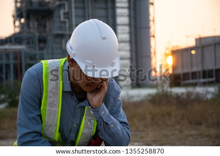 Workers Asian man sitting stressed. Unemployment crisis, corona virus covid-19 pandemic impact Asia Thailand. Business shutdown, Unemployed dismissed concept