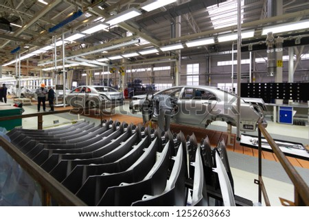 Workers assemble a vehicle body. process of welding cars. Modern Assembly of cars at the plant. automated build process of the car body