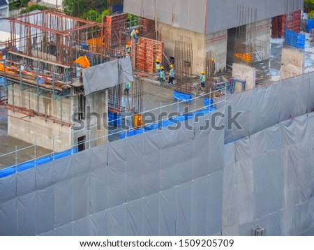 workers at construction site, Construction site workers, Construction site workers are building, View of construction site in progress during daytime. #1509205709