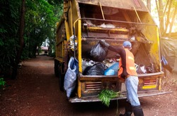 Workers collect garbage with Garbage collection truck