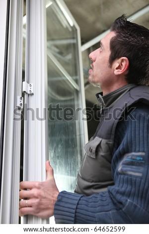 Workers laying glass door