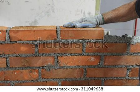 Workers masonry Clay brick to wall