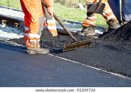 Workers on a road construction, industry and teamwork stock photo