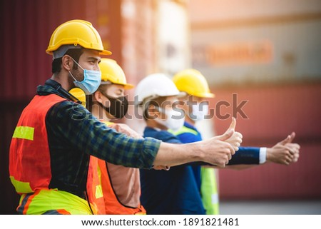 Workers person wear protective surgical face masks for safety in machine industrial factory, container yard manufacturing site, foreman and engineer Photo stock ©
