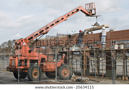 Workers Placing the Capstone