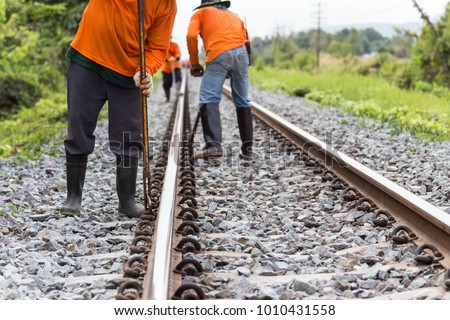 Workers preparing rail for maintenance of the railway.