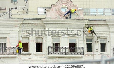 Workers restore the building