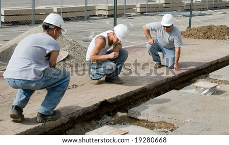 Workers Running a Chalk Line