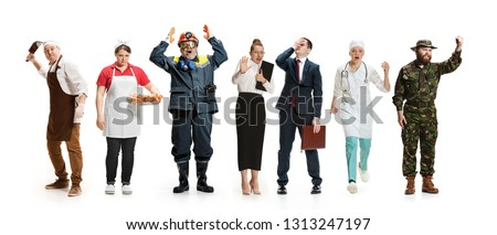 Workers strike concept. Collage of different professions. Group of angry men and women in uniform screaming at studio isolated on white background. Buisiness, professional concepts #1313247197