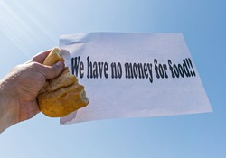 Workers' strike for non-payment of salaries of wages. A worker holds in his hand a piece of bread and a banner, with the message