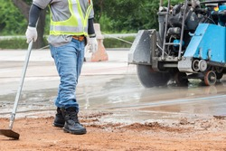 Workers use Road Cutters Engine.Concrete Road Cutters