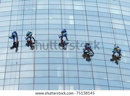 Workers washing windows