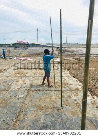 Workers working in shrimp ponds and fish ponds To prepare the pond before raising #1348982231