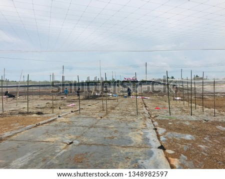 Workers working in shrimp ponds and fish ponds To prepare the pond before raising #1348982597