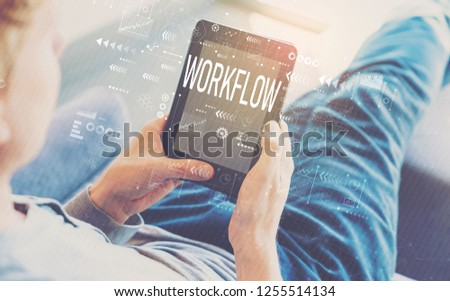 Workflow with man using a tablet in a chair