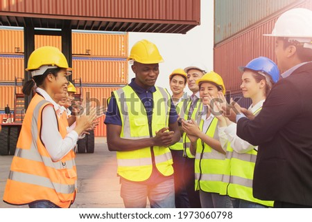 Workforce of the male and female export logistics business welcomes the outstanding workforce for the African American male workers for the best work for all to recognize their talents.  Stock photo ©