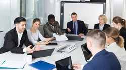 workgroup of business discuss ideas for teamwork in the office