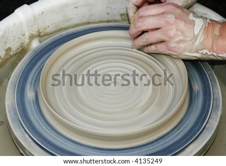 Working a clay pot