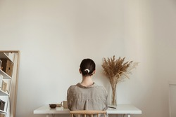 Working at home concept. Girl working at home. Modern home living room interior design. Girl boss, lady boss.Aesthetic minimalist workspace background. Blog, social media, web, magazine template.