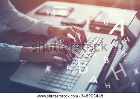 Working at home with laptop woman writing a blog. Female hands on the keyboard.