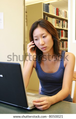 working at the library - stock photo