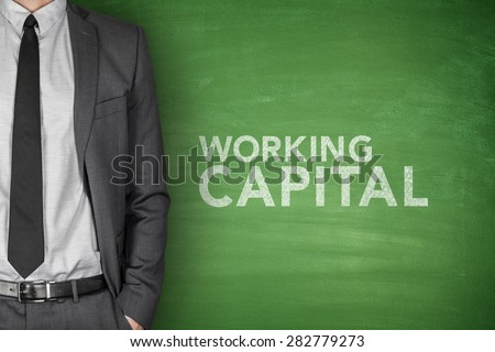 Working capital on green blackboard with businessman