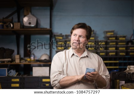 Working class manager in machine shop.