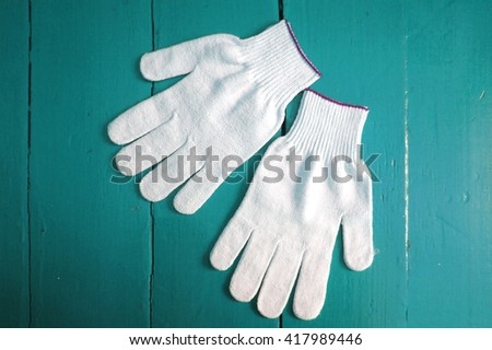 Working cloth gloves on wooden background