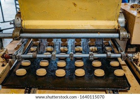 Working cookie forming machine in confectionery factory