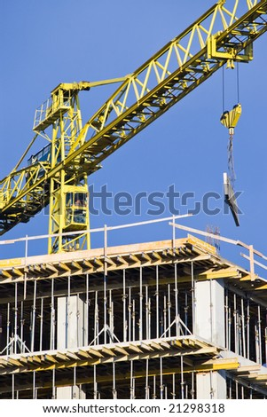 working crane and building on blue sky
